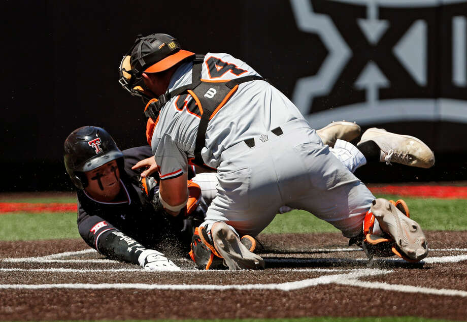 Texas Tech's Brian Klein (5) slides safely into home plate around Oklahoma State's Colin Simpson (24) during the fourth inning in Game 1 of an NCAA college baseball super regional tournament Friday, June 7, 2019, in Lubbock, Texas. (AP Photo/Brad Tollefson) Photo: Brad Tollefson/Associated Press
