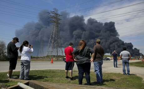 People gathered to watch as firefighters battled the petrochemical fire at Intercontinental Terminals Company in March.
