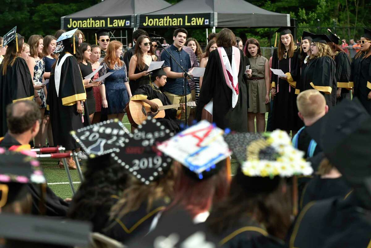 Milford, Connecticut - Friday, June 7, 2019: The Jonathan Law H.S. Concert Choir performs during the Jonathan Law High School of Milford 2019 Graduation exercises Friday evening at the Law H.S. football field.