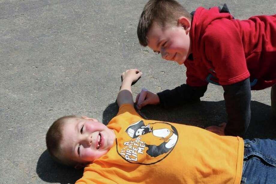 These boys were enjoying themselves as they took part in the events at Harbor Beach Elementary School's annual field day. (Submitted Photo)