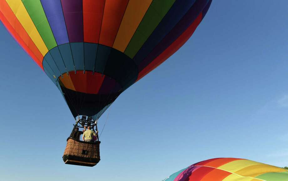 """Hot air balloon """"Light N Up"""" takes flight during the Cambridge Valley Balloon Festival on Friday, June 7, 2019 at Cambridge Central School in Cambridge, NY. (Phoebe Sheehan/Times Union) Photo: Phoebe Sheehan, Albany Times Union / 40047171A"""