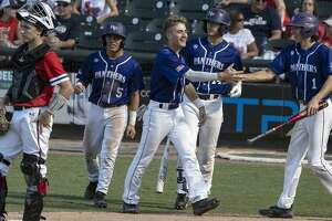 Fort Bend Ridge Point Jacob Garcia, (5), Justin Vossos, (7), and Preston Steszewski, (1), celebrate scoring on a three-run double hit by teammate Jack Baker, (3), as Gabe Colaianni, (14), waits to bat and McKinney Boyd Garrett Mitchell, (17), looks on during the fourth inning of the UIL Class 6A state semifinals held at the Dell Diamond, Friday, June 7, 2019, in Round Rock, Texas. Fort Bend Ridge Point defeated McKinney Boyd 5-2. (Rodolfo Gonzalez for Houston Chronicle)