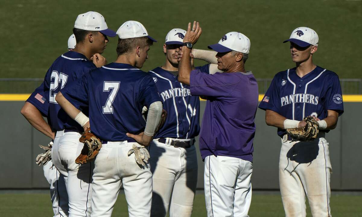 Fort Bend Ridge Point Clinton Welch, head coach, talks to his team as they make a pitching change against McKinney Boyd during the seventh inning of the UIL Class 6A state semifinals held at the Dell Diamond, Friday, June 7, 2019, in Round Rock, Texas. Fort Bend Ridge Point defeated McKinney Boyd 5-2. (Rodolfo Gonzalez for Houston Chronicle)
