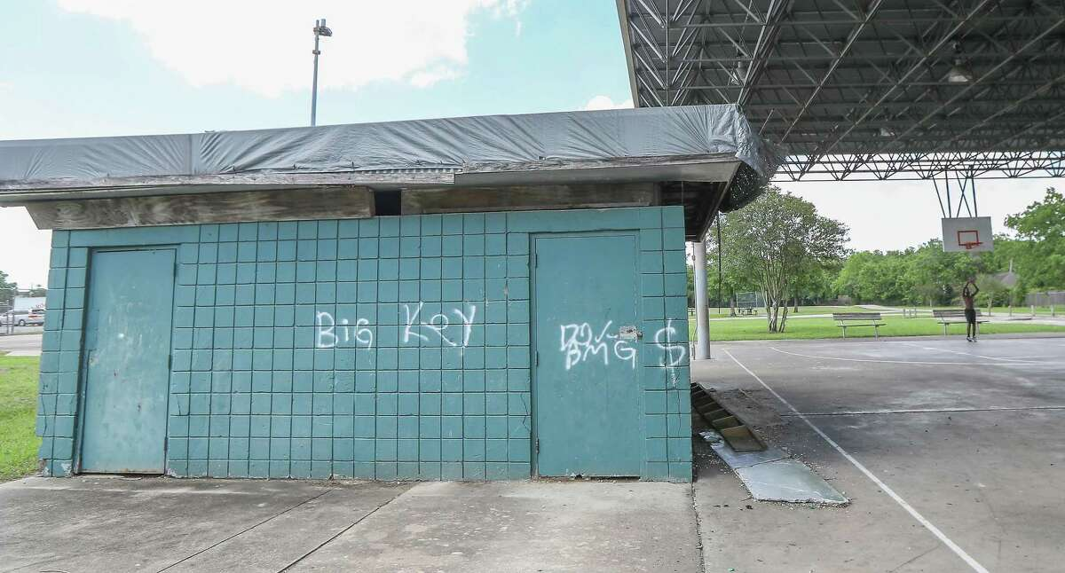 A small building has been tagged in Zollie Scales Park as a youth practices basketball Friday, June 7, 2019, in Houston. The park on Corder at Springhill was a scene where one person was killed during a party in June of 2018.