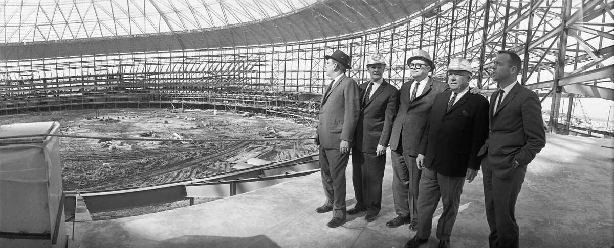 Harris County Commissioners Kyle Chapman and Philip Sayers, former County Judge Roy Hofheinz, National League President Warren Giles, and astronaut Alan Shepard view the interior of the Harris County Domed Stadium (Astrodome) on March 12, 1964. The facility by then wasfree of the support towers that had held the dome up until the structural steel framing was in place.