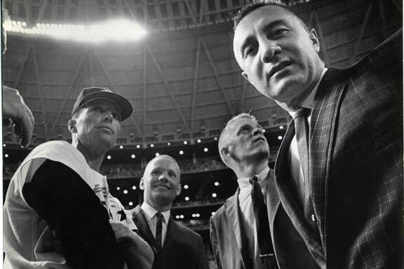 Astronaut Gus Grissom, right, with fellow astronauts, Neil Armstrong and Russell Schweickart, and Astros third base coach Jim Busby before the the 1965 season opening game at the Astrodome April 12, 1965.