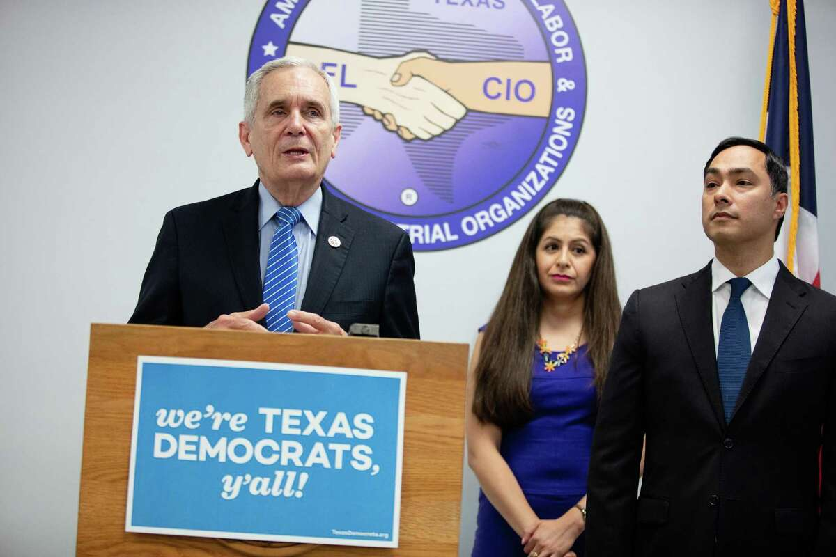 Congressman Lloyd Doggett speaks to the media Friday, questioning Texas Gov. Greg Abbott's possible involvement in the state's planned purge of some 95,000 voters. Behind Doggett are United We Dream Co-Founder Julieta Garibay and Congressman Joaquin Castro.