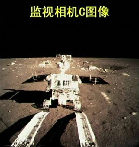 """This image taken from video shows China's first moon rover touching the lunar surface and leaving deep traces on its loose soil on Dec. 15, 2013, several hours after the country successfully carried out the world's first soft landing of a space probe on the moon in nearly four decades. The writing at the top of the image reads """"Surveillance Camera C image."""""""