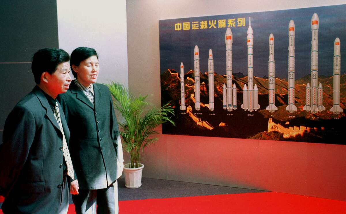 Visitors to a Chinese space exhibition view the various models of Chinese Long March rockets at the military museum in Beijing on Sept. 28, 2000. At the time, China planned to explore the moon and to take part in a Mars expedition, members of the secretive space program said Wednesday. It landed on the moon in 2013 - the first landing in nearly four decades.
