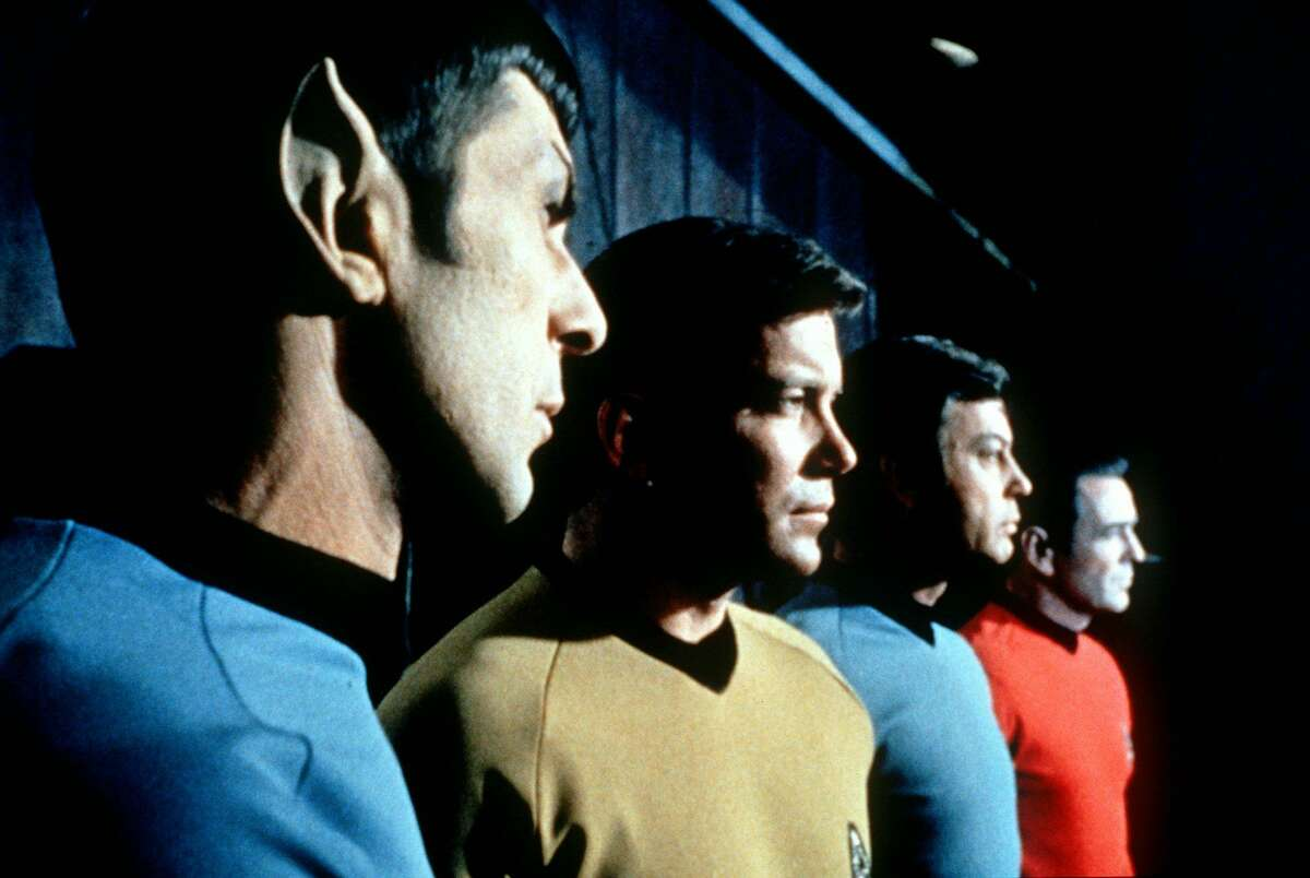 """This undated file photo shows actors in the TV series """"Star Trek,"""" from left, Leonard Nimoy as Mr. Spock, William Shatner as Captain Kirk, DeForest Kelley as Doctor McCoy and James Doohan as Scotty."""
