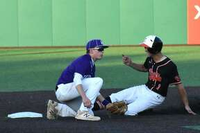 Edwardsville shortstop Josh Ohl slides safely into second base with a stolen base in the second inning.
