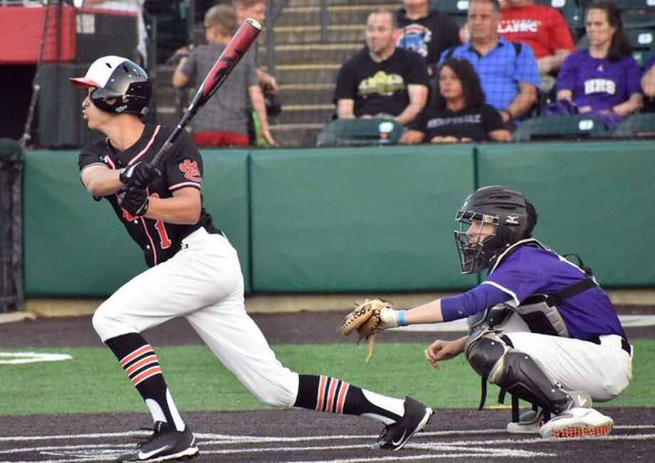 Edwardsville shortstop Josh Ohl rips a single in the second inning against Hampshire in the Class 4A state semifinals on Friday in Joliet. Photo: Matt Kamp | For The Telegraph