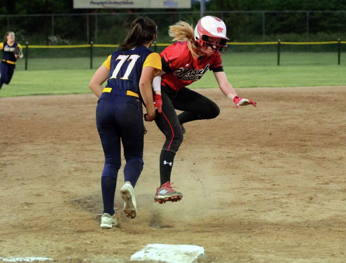 Masuk's Megan McFarland (7) reaches third during Class L softball action against East Haven in Stratford, Conn., on Friday June 7, 2019.