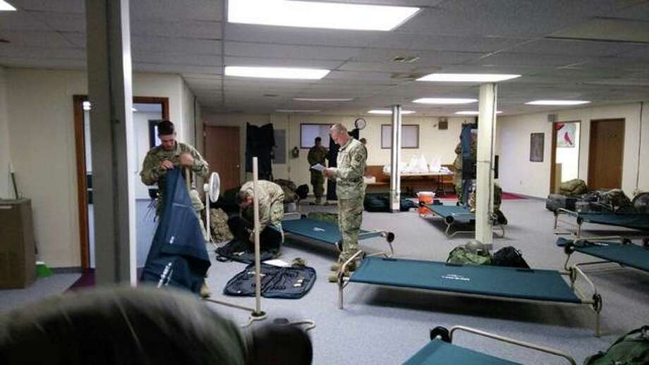 National Guardsmen set up cots for their stay inside the Alton Police Department command center. They're expected to be stationed there for between 10 days and two weeks. Photo: Photos Courtesy Of Alton Police Department Public Information Officer Pfc. Emily Hejna
