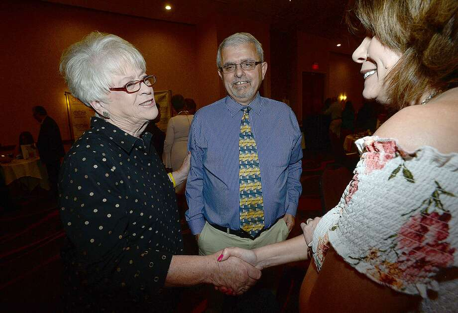 Paula O'Neal with Some Other Place talks with Harold Mann and guest during cocktail hour before being named Newsmaker of the Year award winner during the Press Club of Southeast Texas' 28th annual Excellence in the Media & Newsmaker of the Year Awards Friday night. Photo taken Friday, June 7, 2019 Kim Brent/The Enterprise Photo: Kim Brent / The Enterprise / BEN