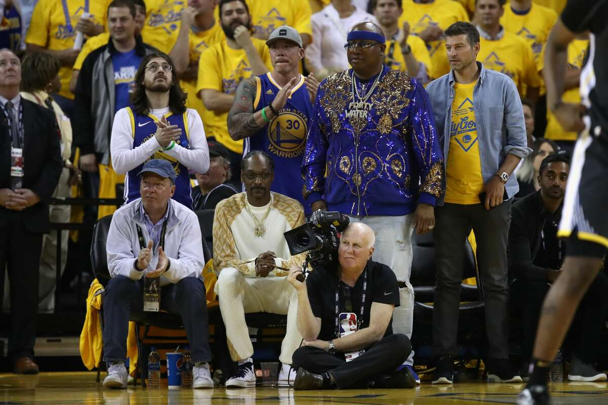 Snoop Dog and E-40 attend Game Four of the 2019 NBA Finals between the Golden State Warriors and the Toronto Raptorsat ORACLE Arena on June 07, 2019 in Oakland, California.