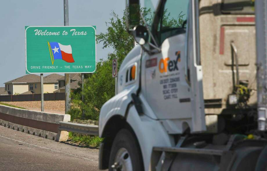 A tractor trailer crosses the World Trade Bridge back into the United States from Mexico in this May 21, 2019 photo. Analysts recently said the USMCA is unlikely to benefit Texas during the COVID-19 pandemic. Photo: Danny Zaragoza / Laredo Morning Times / Laredo Morning Times