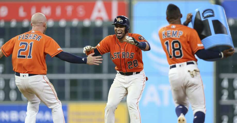 Houston Astros players Derek Fisher (21) and Tony Kemp (18) go to Robinson Chirinos (28) as his walk-off double sent Yuli Gurriel home during the bottom eleventh inning of the MLB game at Minute Maid Park on Friday, June 7, 2019, in Houston. The Houston Astros defeated the Baltimore Orioles 4-3. Photo: Yi-Chin Lee/Staff Photographer