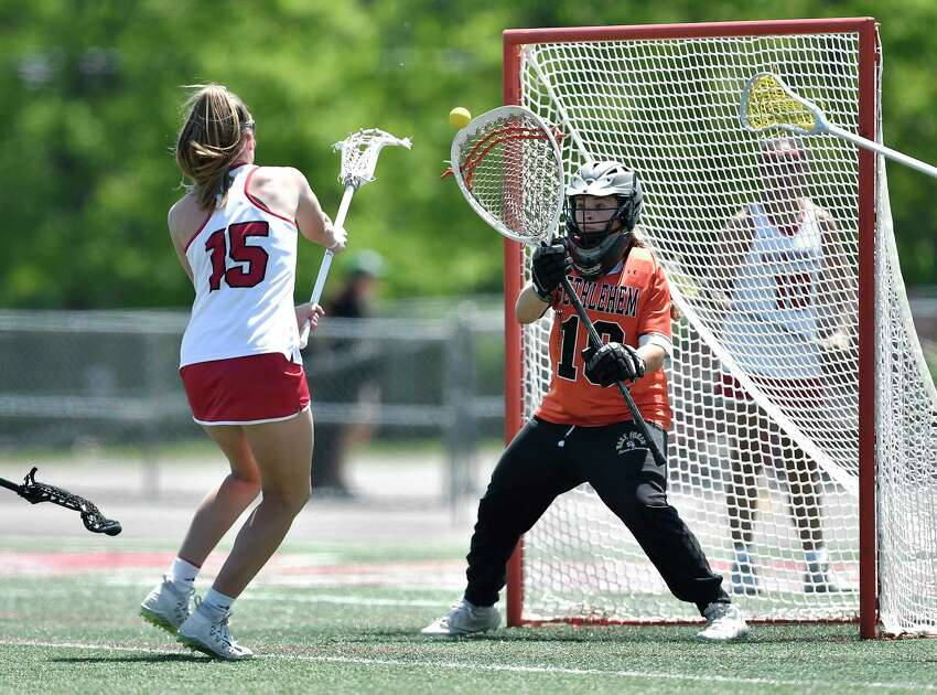 Bethlehem goalie Sophia Koch, right, makes a save against Baldwinsville's Sarah Klein during a Class A semifinal at the NYSPHSAA Girls Lacrosse Championships in Cortland, N.Y., Friday, June 7, 2019. Bethlehem?s season ended with a 15-14 overtime loss to Baldwinsville-III. (Adrian Kraus / Special to the Times Union)