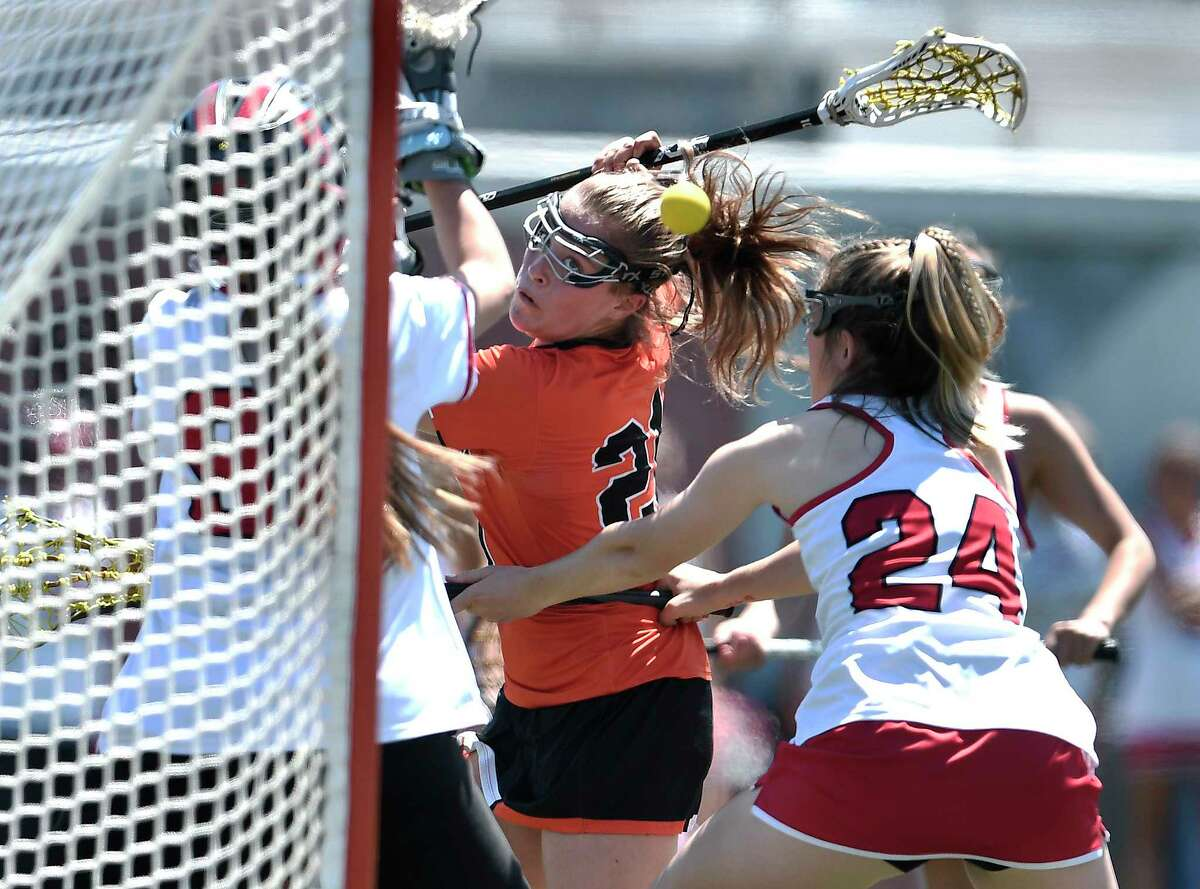 Bethlehem's Lauren Riker takes a shot behind her head for the Eagles? fourth goal against Baldwinsville during a Class A semifinal at the NYSPHSAA Girls Lacrosse Championships in Cortland, N.Y., Friday, June 7, 2019. Bethlehem?s season ended with a 15-14 overtime loss to Baldwinsville-III. (Adrian Kraus / Special to the Times Union)