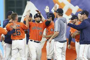Houston Astros players congratulate catcher Robinson Chirinos (28) as his walk-off double sent Yuli Gurriel home during the bottom eleventh inning of the MLB game against the Baltimore Orioles at Minute Maid Park on Friday, June 7, 2019, in Houston. The Houston Astros defeated the Baltimore Orioles 4-3.