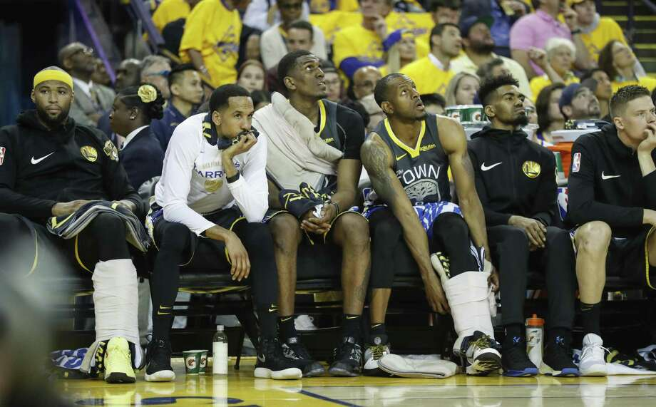 Golden State Warriors' Kevon Looney sits on the bench in the second quarter during game 4 of the NBA Finals between the Golden State Warriors and the Toronto Raptors at Oracle Arena on Friday, June 7, 2019 in Oakland, Calif. Photo: Scott Strazzante / The Chronicle / online_yes