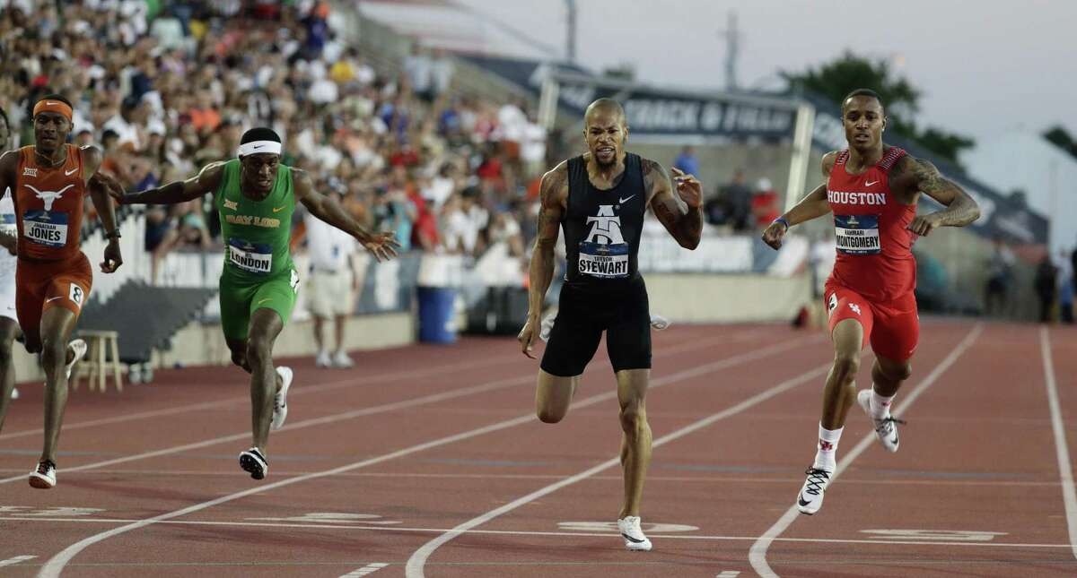 Houston's Kahmari Montgomery, right, edges out North Carolina A&T's Trevor Stewart, second from right, to win the men's 400 meters during the NCAA outdoor track and field championships in Austin, Texas, Friday, June 7, 2019. (AP Photo/Eric Gay)