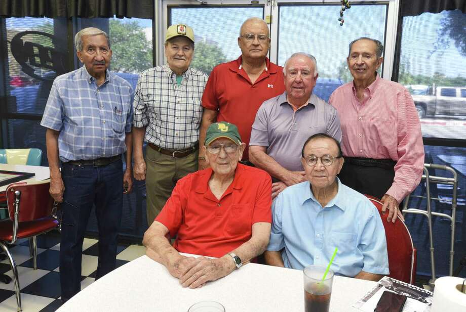 The 1956 Martin state basketball championship team reunited Friday at Pat's Kitchen as they were presented a poem that depicted the emotion that Tiger fans felt after they won the state title. Photo: Danny Zaragoza /Laredo Morning Times / Laredo Morning Times