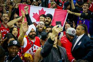 Raptors fans erupt in cheer after winning Game 4 of the NBA Finals between the Golden State Warriors and the Toronto Raptors at Oracle Arena in Oakland, California, on Friday, June 7, 2019. The Raptors defeated the Warriors 105-92.