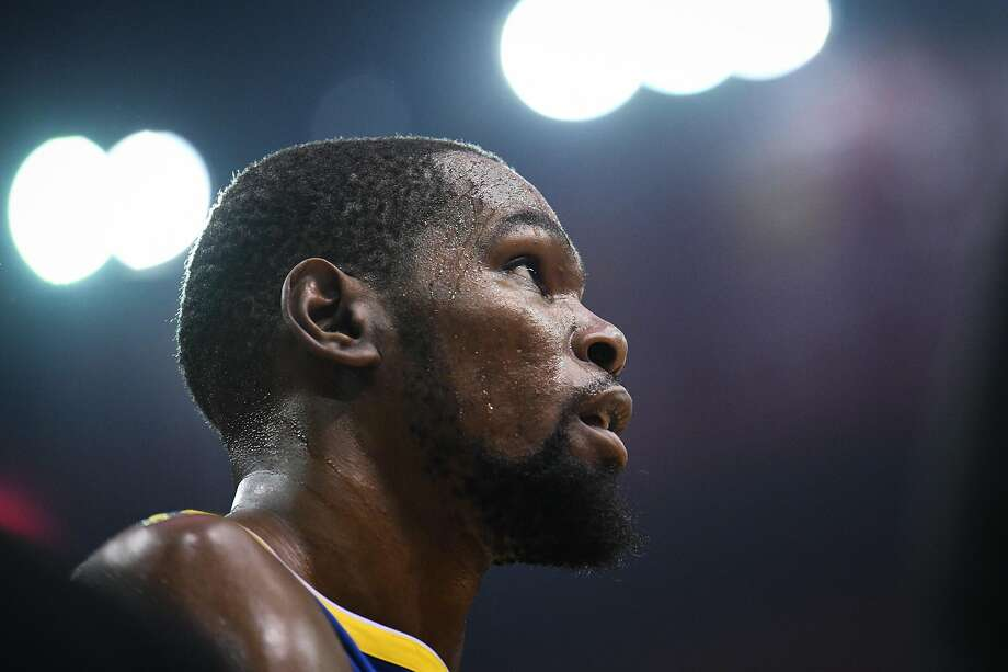 Golden State Warriors forward Kevin Durant (35) is walks away from the basket following a play during the first half in game 4 of the NBA Western Conference Semifinals between the Golden State Warriors and Houston Rockets at the Toyota Center in Houston, Texas, on Monday, May 6, 2019. Photo: Loren Elliott, Special To The Chronicle