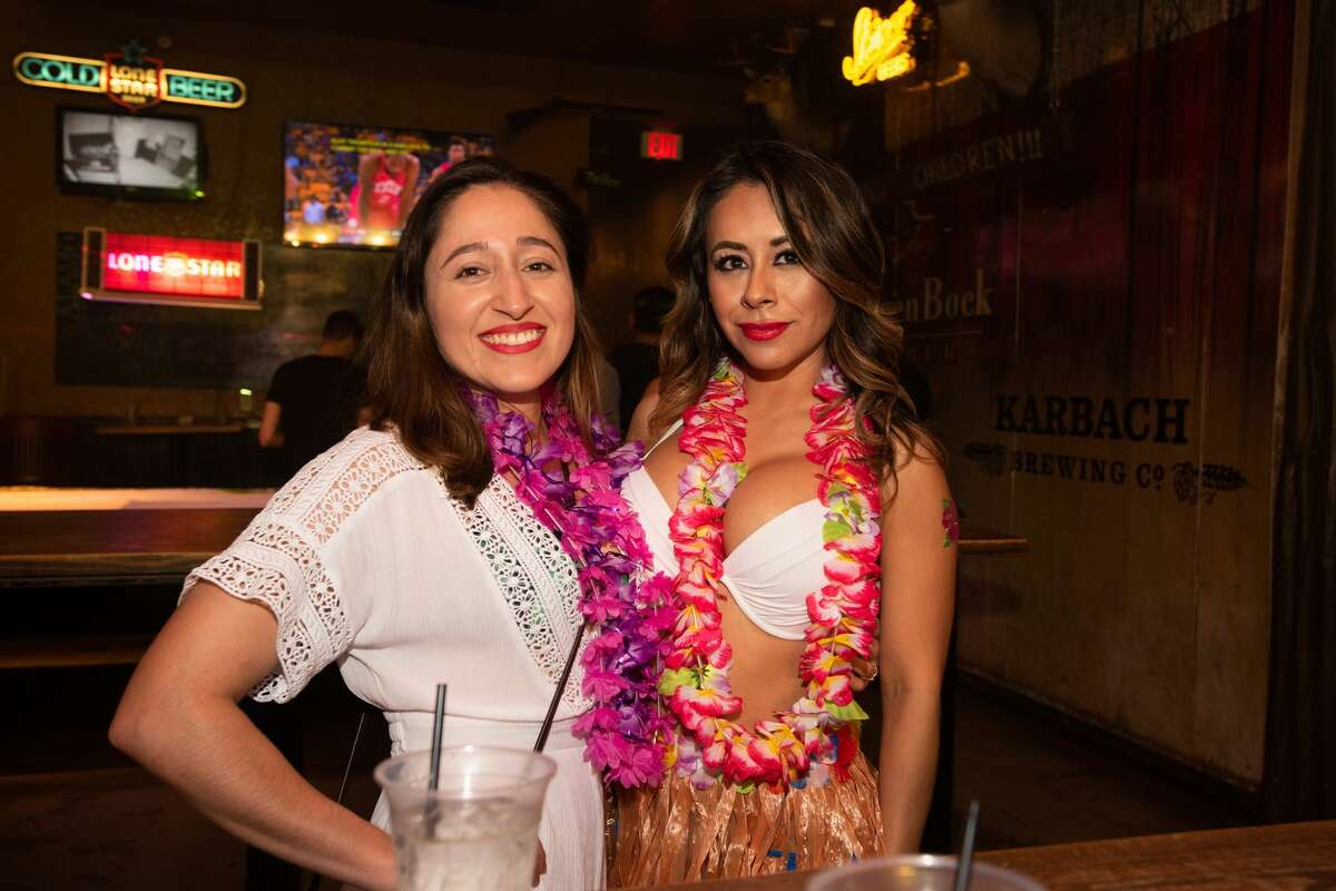 Locals flooded downtown streets in festive and colorful luau outfits for the monthly themed pub run of San Antonio bars Friday night, June 7, 2019.