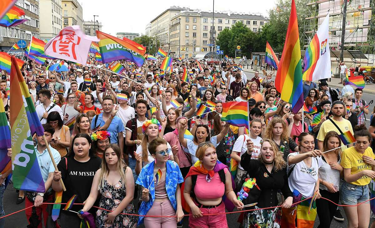 People wave rainbow flags during the Baltic gay pride parade on June 8, 2019 on the streets of the Polish capital Warsaw. (Photo by Janek SKARZYNSKI / AFP)JANEK SKARZYNSKI/AFP/Getty Images