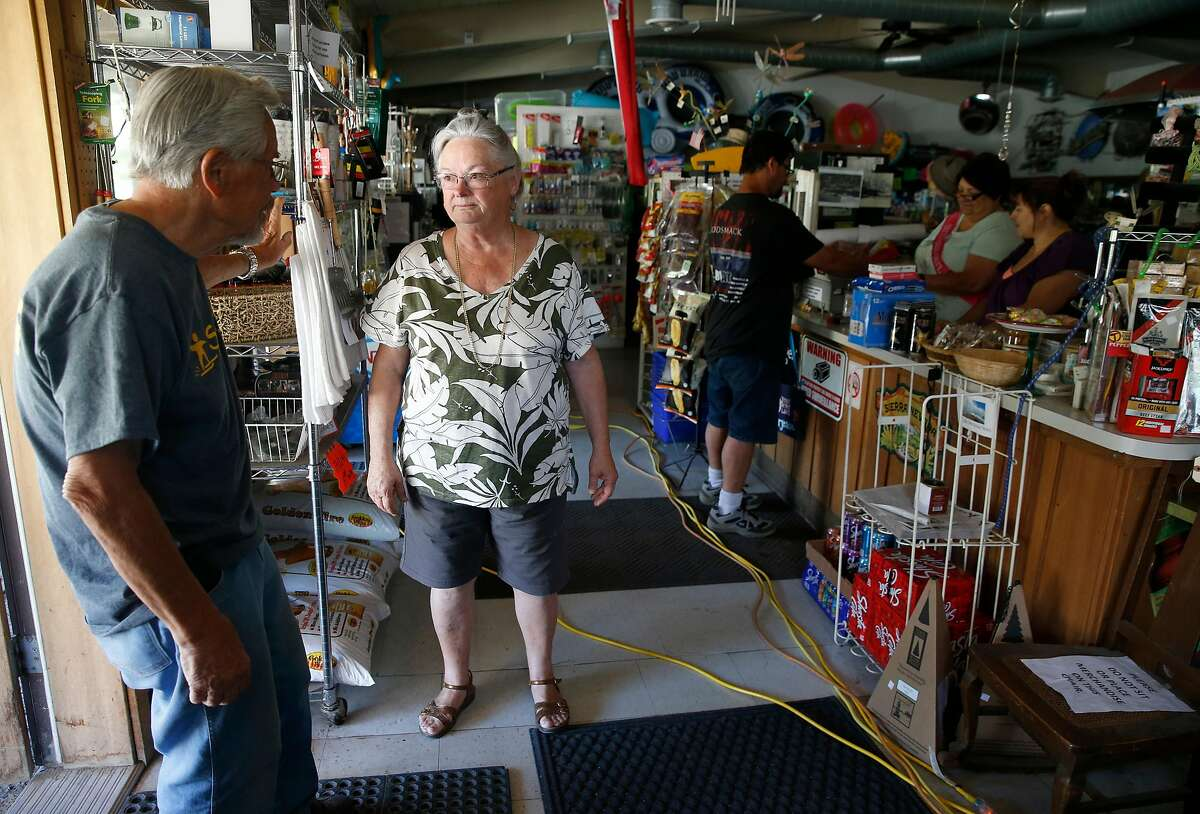 Spanish Flat Country Store owner Marcia Ritz and her fiance Jerry Rehmke discuss the power outage in Lake Berryessa, Calif. on Saturday, June 8, 2019. PG&E enabled its public power safety shutoff protocol resulting in outages for 1,600 customers in the area.