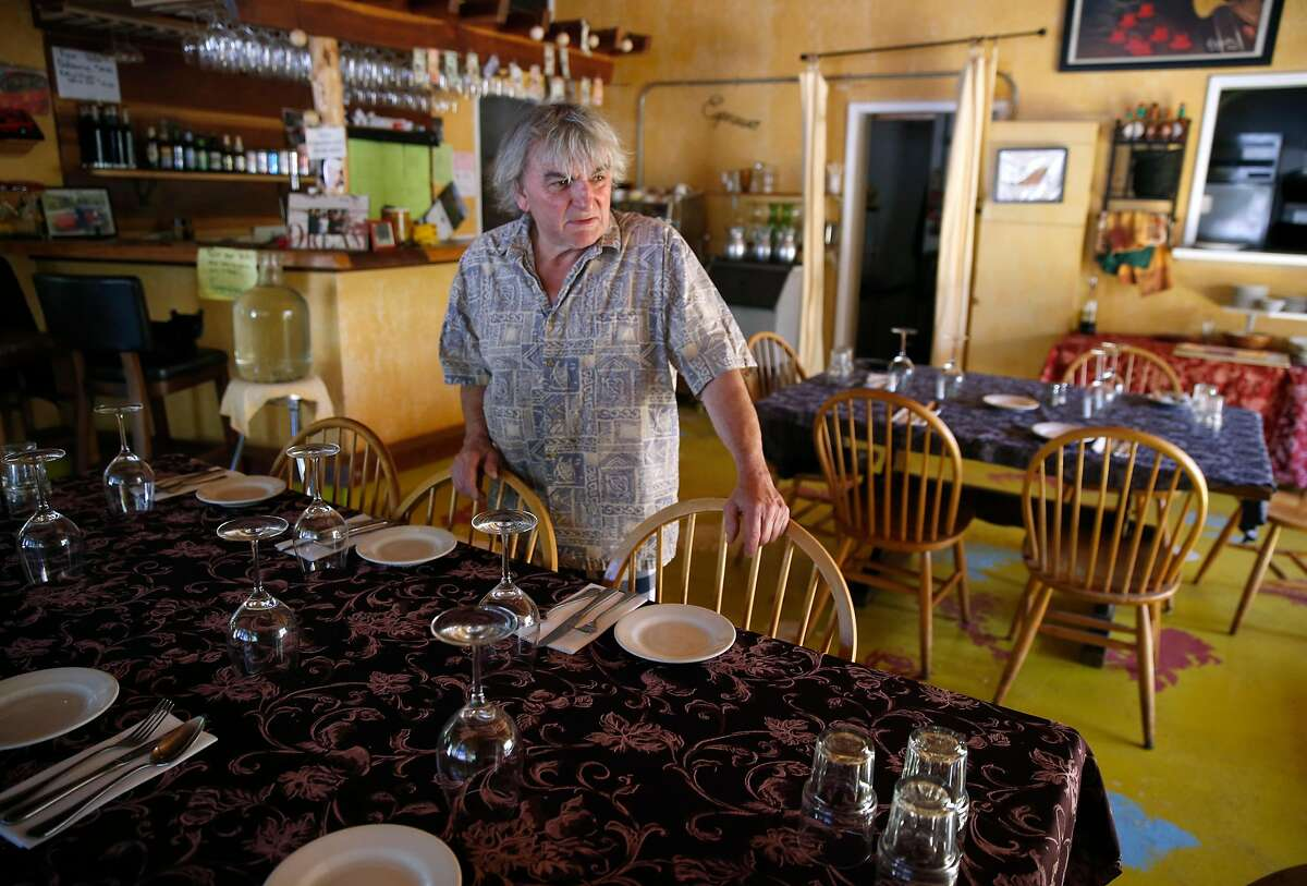 Cucina Italiana restaurant owner Stefano Gusberti stands in the darkened dining room which would normally be filled with lunchtime diners in the Spanish Flat area of Lake Berryessa, Calif. on Saturday, June 8, 2019. PG&E enabled its public power safety shutoff protocol resulting in outages for 1,600 customers in the area.