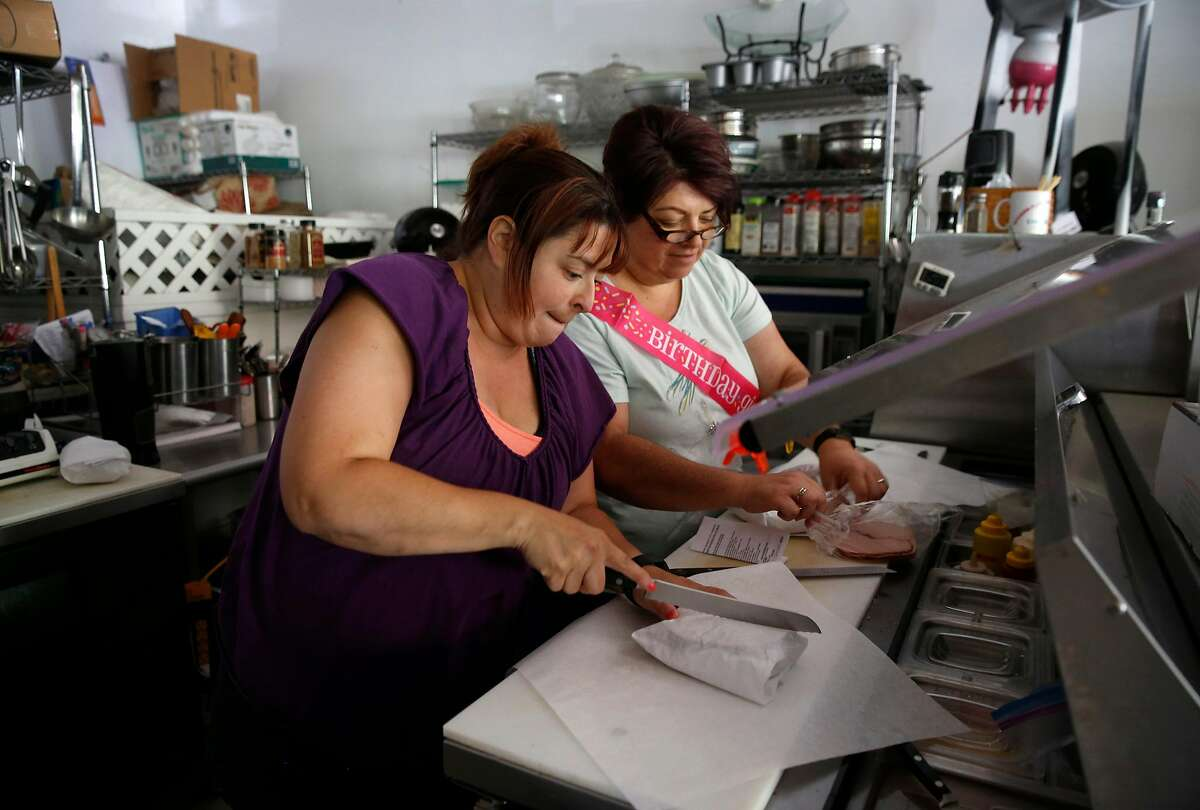 Elaine Medina (left) and her mother Lucy Medina make cold sandwiches for customers at the Spanish Flat Country Store and Deli in Lake Berryessa, Calif. on Saturday, June 8, 2019. Hot sandwiches were not available because to the power outage. PG&E enabled its public power safety shutoff protocol resulting in outages for 1,600 customers in the area.