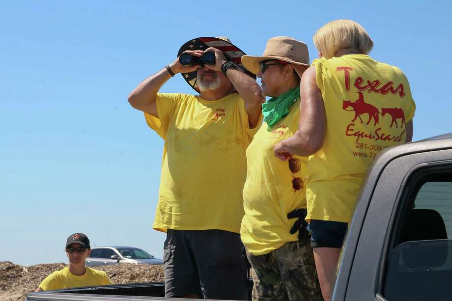 June 8, 2019: Members of the Texas EquuSearch team scan the horizon at the Texas City Dike, and participate in the rescue efforts to find Kemah Chief of Police Chris Reed,  who has been reported missing. Photo: Leslie Plaza Johnson, Contributor / Houston Chronicle
