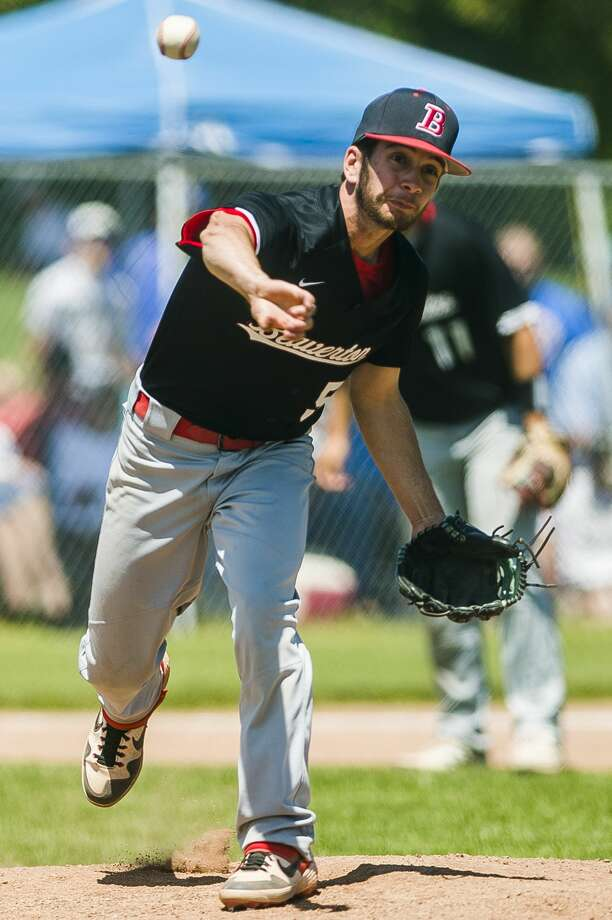 Beaverton's Drew Grove pitches the ball during a Division 3 regional final against Evart on Saturday, June 8, 2019 in Clare. (Katy Kildee/kkildee@mdn.net) Photo: (Katy Kildee/kkildee@mdn.net)