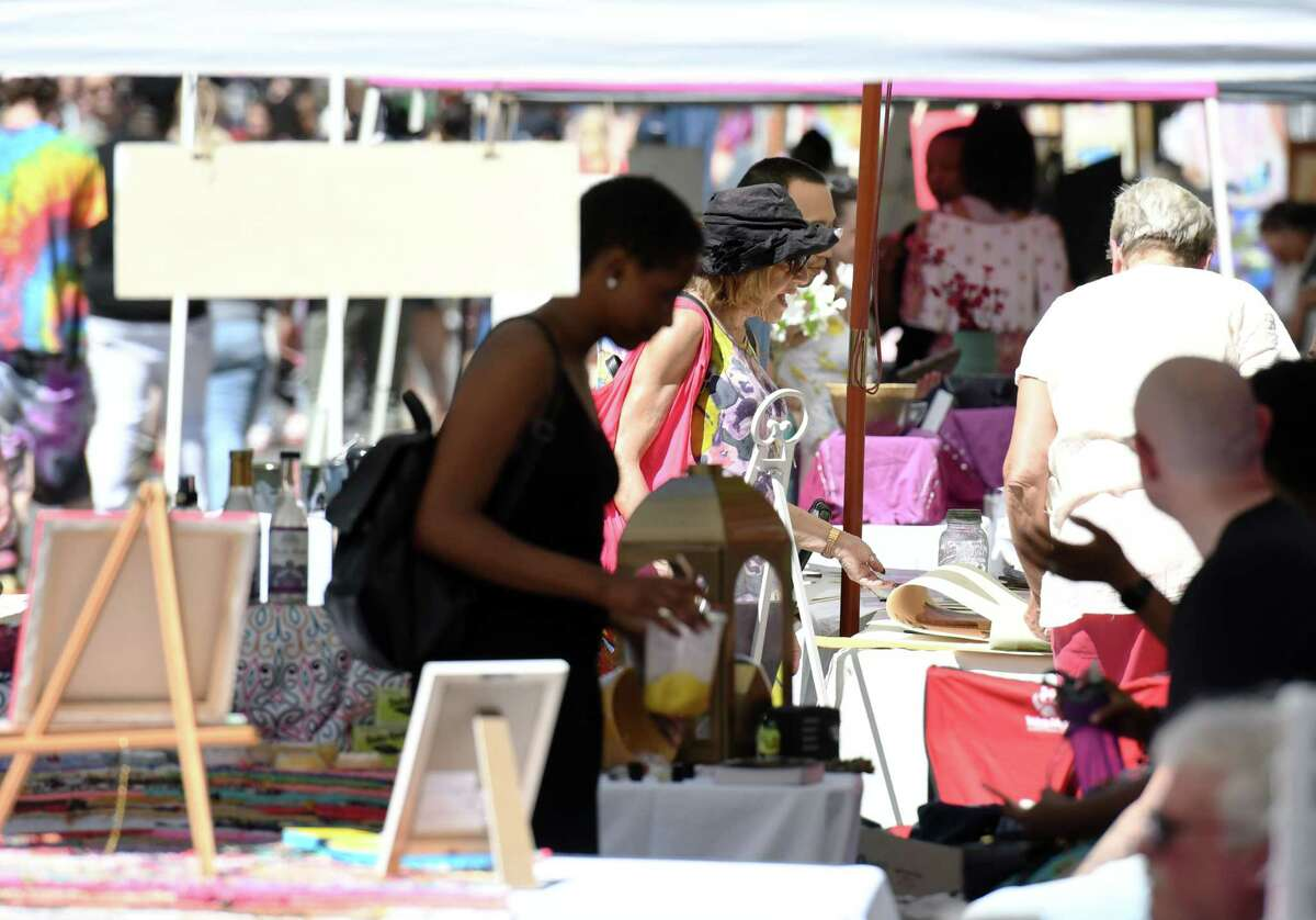 People browse the vendors during Art on Lark in 2019. This year the event will be held on Saturday, Aug. 28. (Phoebe Sheehan/Times Union)