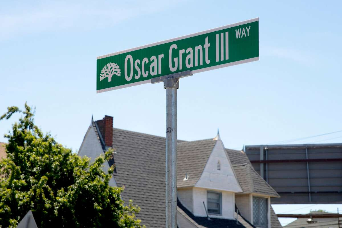 A street sign marking the newly-minted Oscar Grant III Way, honoring the late Oscar Grant, is unveiled at Fruitvale BART Station in Oakland, Calif. Saturday, June 8, 2019.