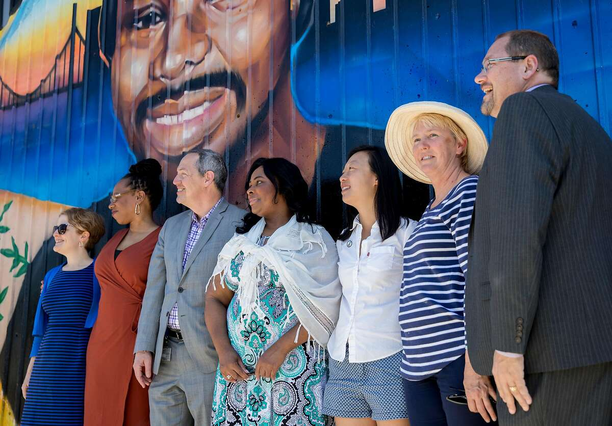 Wanda Johnson (center), mother of the late Oscar Grant, poses for pictures with the BART Board of Directors during a mural and street naming unveiling for Oscar Grant at Fruitvale BART Station in Oakland, Calif. Saturday, June 8, 2019.