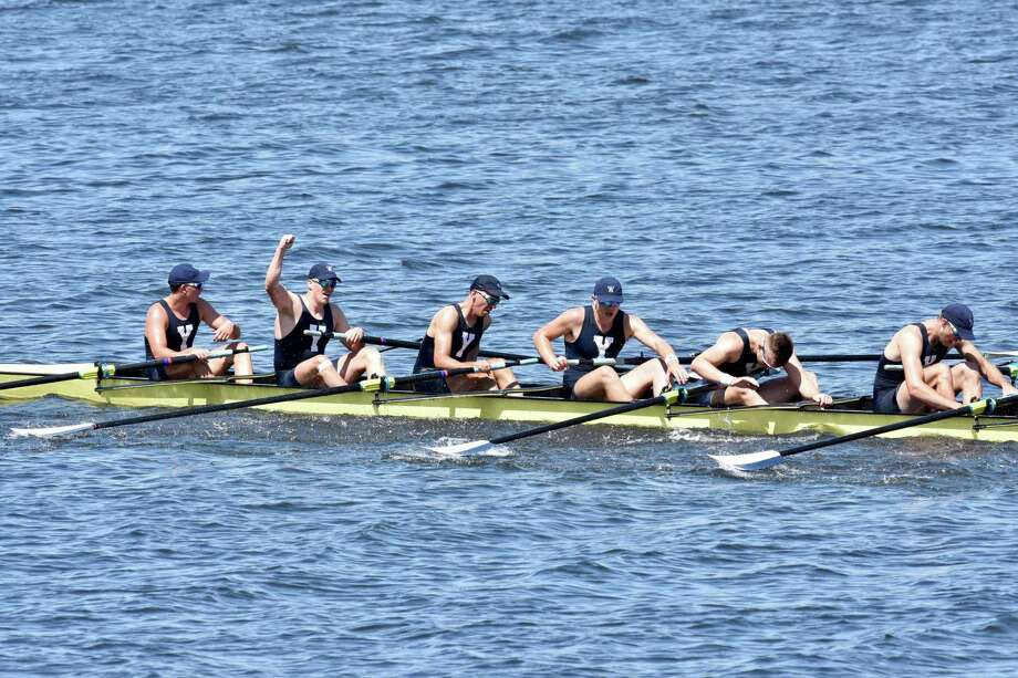 Members of the Yale first varsity crew celebrate their win over rival Harvard in the annual Regatta on Saturday. Photo: Yale Athletics