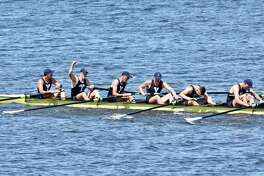 Members of the Yale first varsity crew celebrate their win over rival Harvard in the annual Regatta on Saturday.