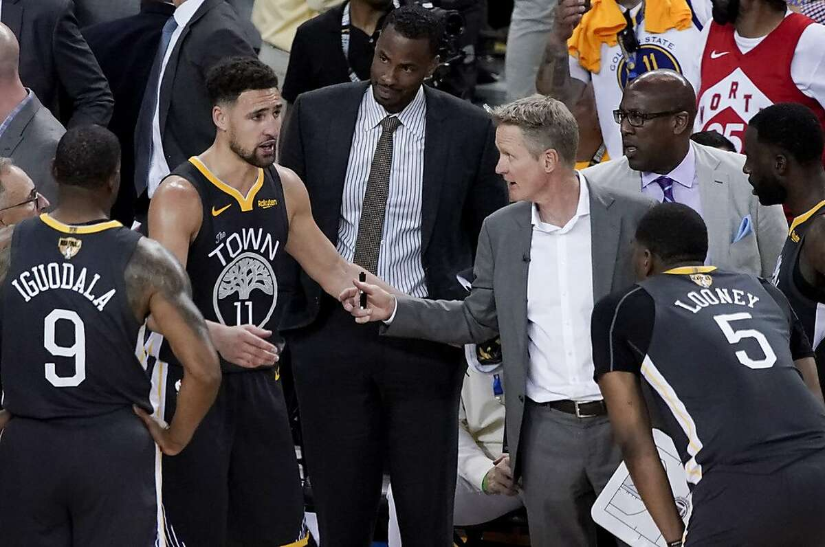 Golden State Warriors head coach Steve Kerr, middle right, talks with guard Klay Thompson (11) during the second half of Game 4 of basketball's NBA Finals against the Toronto Raptors in Oakland, Calif., Friday, June 7, 2019. (AP Photo/Tony Avelar)