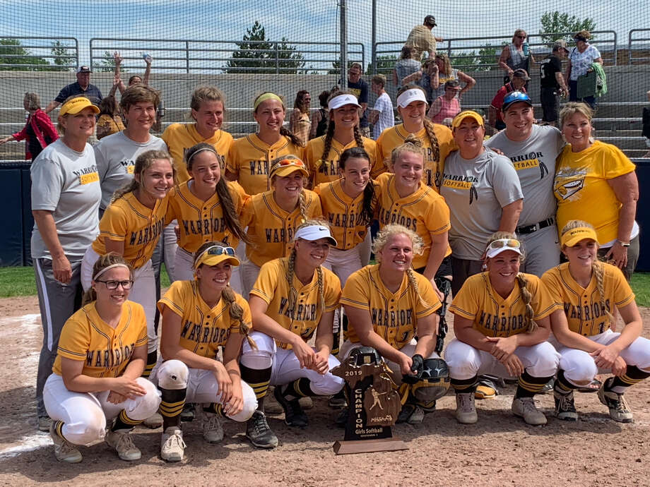 Bay City Western's softball team poses with the Division 1 regional championship trophy Saturday at Saginaw Valley State University. Photo: Fred Kelly/fred.kelly@mdn.net