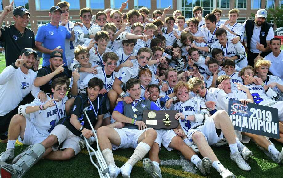 The Darien High School Blue Wave celebrates after winning against the Wilton High School Warriors in their Class L boys lacrosse championship Saturday, June 8, 2019, at Brien McMahon High School in Norwalk, Conn. Photo: Erik Trautmann / Hearst Connecticut Media / Norwalk Hour
