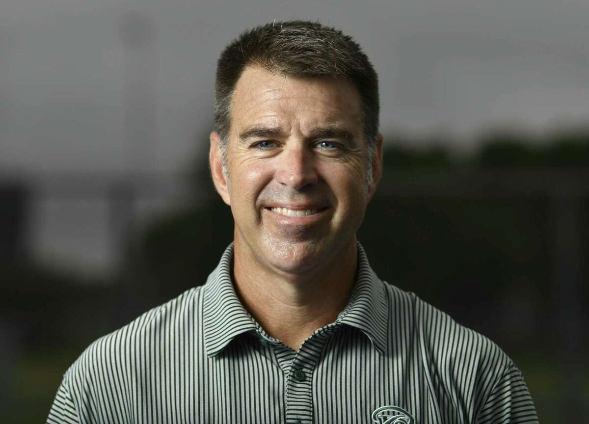 David Daniel, Reagan tennis coach, is the Express-News coach of the year.