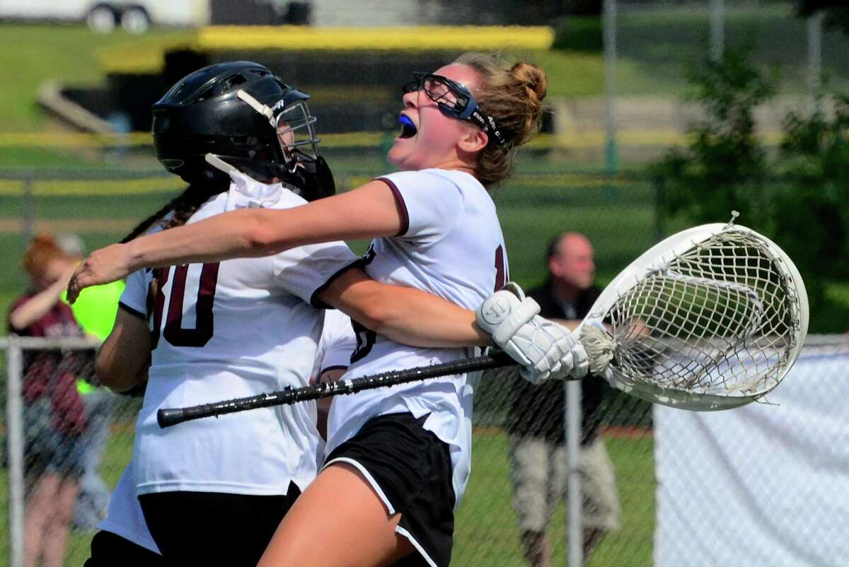East Lyme goalie Maya Rose, left, and Ellie McCoy (18) embrace after the team beat St. Joseph during girls Class M lacrosse action in Milford, Conn., on Saturday June 8, 2019.