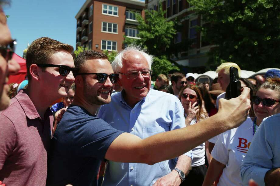 Bernie Sanders takes a photo with some fans during the Capitol City Pride festival in Des Moines, Iowa, on Saturday. Photo: Photo By Christopher Smith For The Washington Post / For The Washington Post