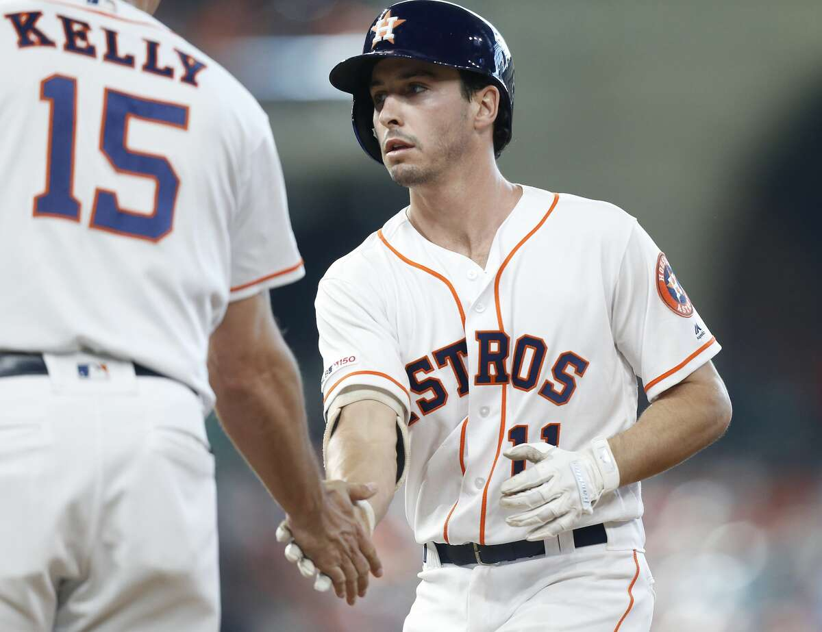 Houston Astros first base coach Don Kelly (15) congratulates Houston Astros Houston Astros catcher Garrett Stubbs (11) after his single in the bottom of the fifth inning against the Baltimore Orioles at Minute Maid Park in Houston on Saturday, June 8, 2019. Astros lead the three-game series 1-0.