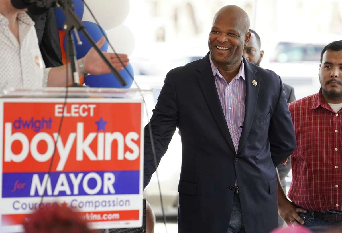 Houston Councilman Dwight Boykins listens as supporter Justin Gardiner speaks during his campaign kick off for mayor held Saturday, June 8, 2019, in Houston.